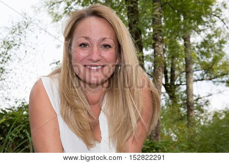 a Portrait of beautiful middle-aged blond woman