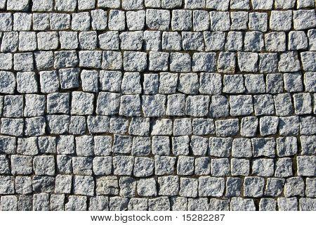 Old grey square brick wall.
