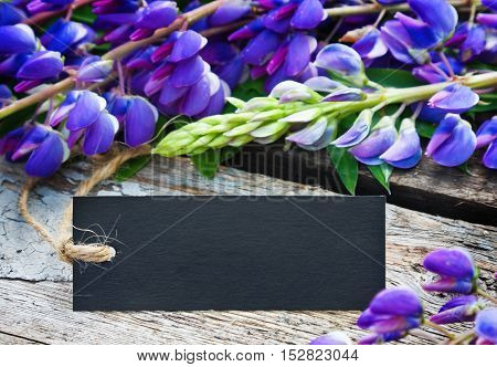 wild flowers and label with space for text on a wooden table