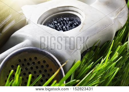 old gas mask on the grass single, equipment