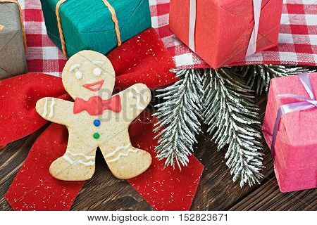 smiling on the background of Christmas gingerbread decorations