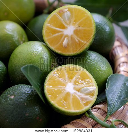 Green Kumquat Fruit On Wooden Background