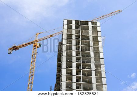 modern monolithic construction of houses against the blue sky