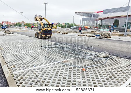 Zrenjanin Vojvodina Serbia - September 25 2015: Crushed segments of safety mobile fence in pile on tiled ground.