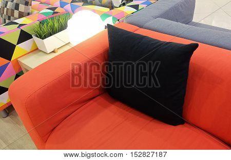 Colorful Modern Cozy Sofa Display in Furniture Store Showroom.