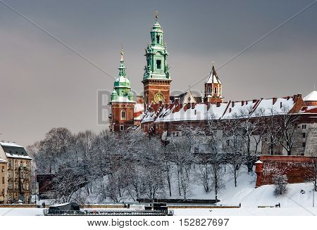 Wawel Cathedral towers in Krakow Poland in a cloudy day in winter in last sunset light before the snowfall