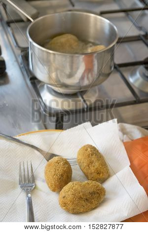 fried sicilian rice balls called arancine or suppli