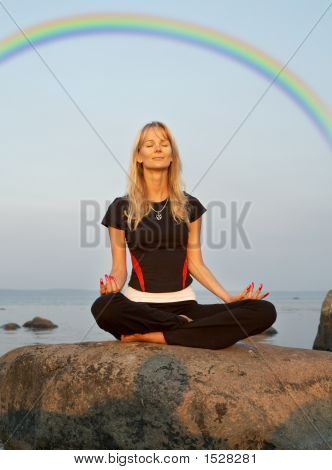 Meditation At The Seashore Under Rainbow