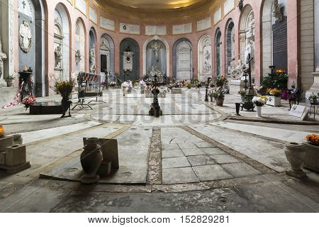 BOLOGNA,ITALY-DECEMBER 7,2016:Arcade inside the monumental cemetery of the Certosa di Bologna during a sunny day.