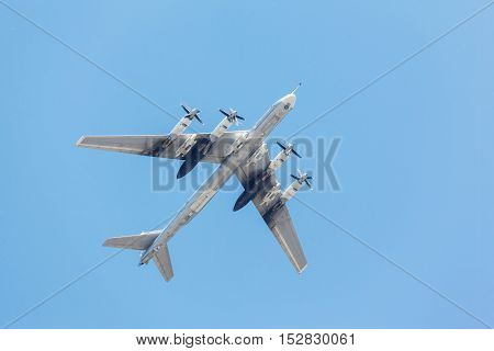 heavy bomber aircraft takes off from the runway on the background of blue sky