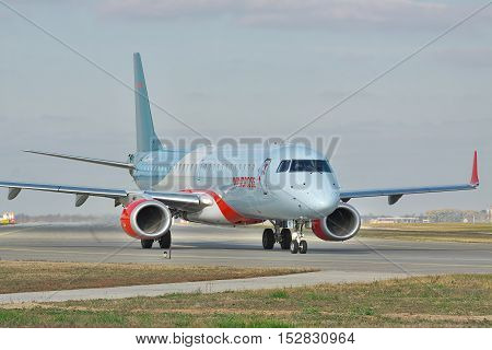 Kiev Region Ukraine - October 23 2011: Embraer ERJ-190 passenger plane on the taxiway before takeoff