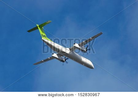 Borispol Ukraine - October 2 2011: Air Baltic De Havilland Canada DHC-8-402Q Dash 8 is taking off into blue sky