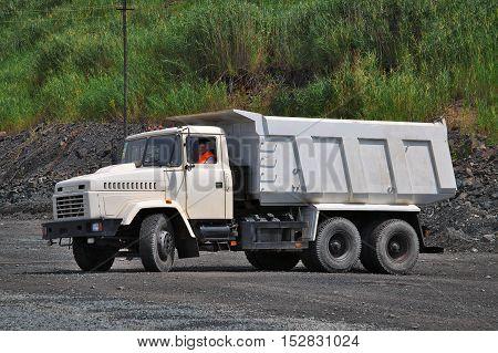 Poltava Region Ukraine - June 26 2010: Dump truck is driving on the opencast mining site
