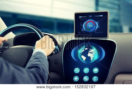 transport, business trip, technology, navigation and people concept - close up of businessman with tablet pc and globe on computer driving car