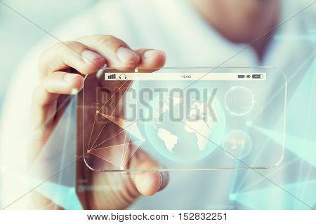 business, technology, science and people concept - close up of male hand holding and showing transparent smartphone earth globe projection