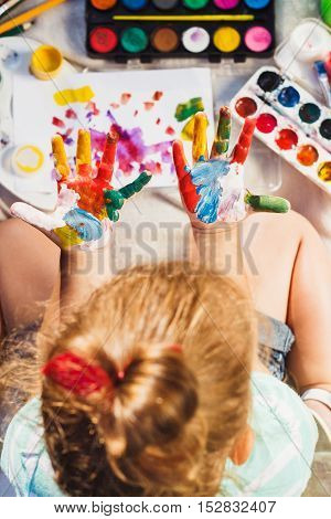 Small Girl Shows Painted Colorful Hands