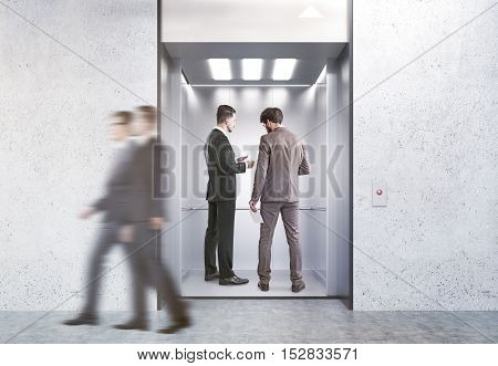 Business people in open elevator in modern office. Concept of working in high building. 3d rendering. Mock up