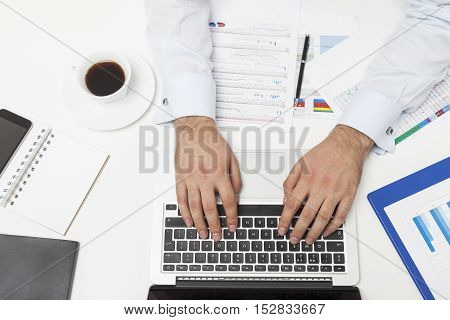 Top View Of Man's Hands Typing On Black And White Keyboard