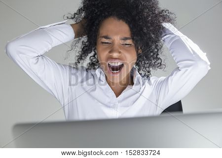 Close Up Of African Office Employee Crying Desperately