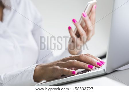 Close Up Of Beautiful African Girl's Hands With Smartphone