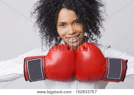 Smiling African Girl Wearing Red Boxing Gloves