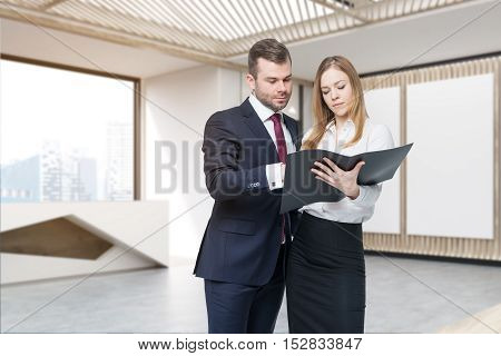 Two people talking in lobby of company with two vertical posters large beautiful reception desk and elevator. Concept of collaboration. 3d rendering. Mock up