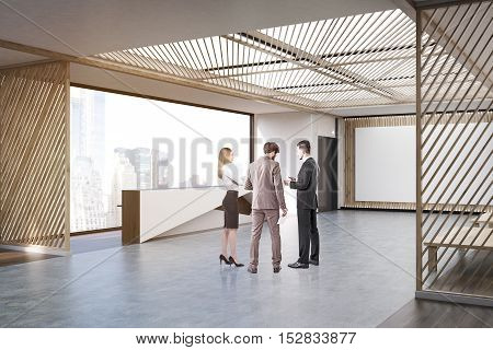 People talking in modern office with large horizontal poster on wooden door reception counter coffee tables and sofas. Concept of waiting room. 3d rendering. Mock up