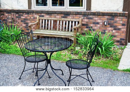 Weathered and worn wooden bench and table for two