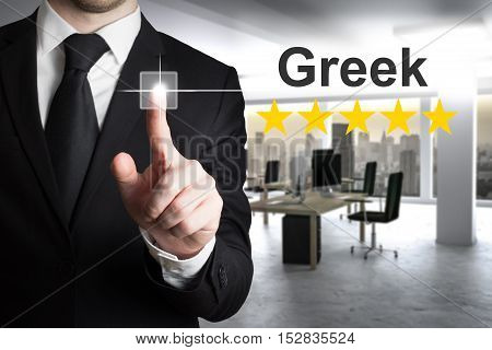 businessman translator in office writing greek in the air