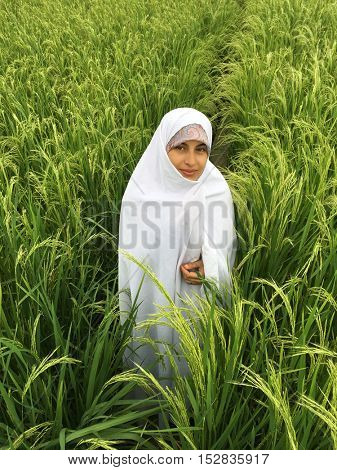 Muslim Arabic woman with scarf in nature
