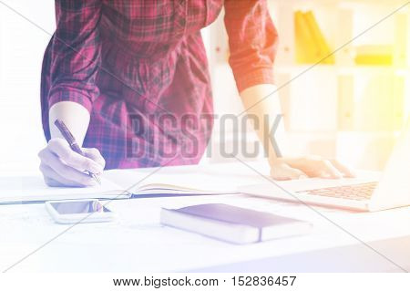 Girl Taking Notes And Leaning At Table