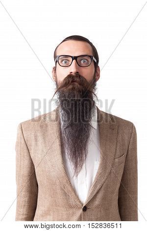 Baffled man wearing glasses and long beard is standing against white background. Concept of eccentric person.