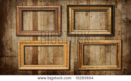 Picture frames hanging on a cedar panel wall.