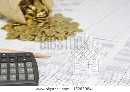 Close Up House With Blur Gold Coins Overflow From Sack
