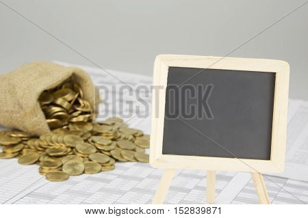 Close Up Empty Blackboard Have Blur Coins Overflow From Sack