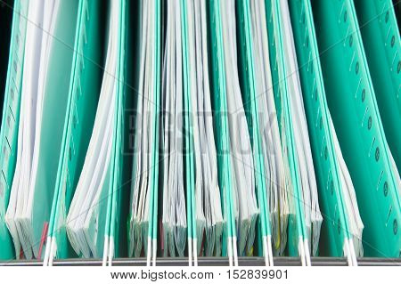 Green Suspension Folder With Paperwork Hang In Cabinet