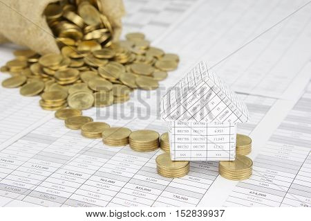 House On Gold Coins Have Blur Money Overflow From Sack