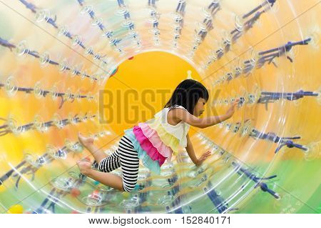 Asian Chinese Little Girl Playing Roller Wheel
