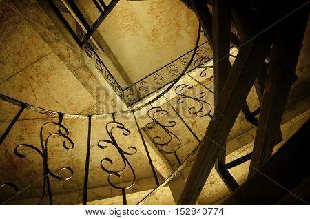 Sleek metal spiral staircase modern architectural interior decoration.