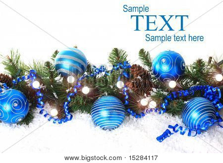 Christmas border with lights, blue ornaments and snow.