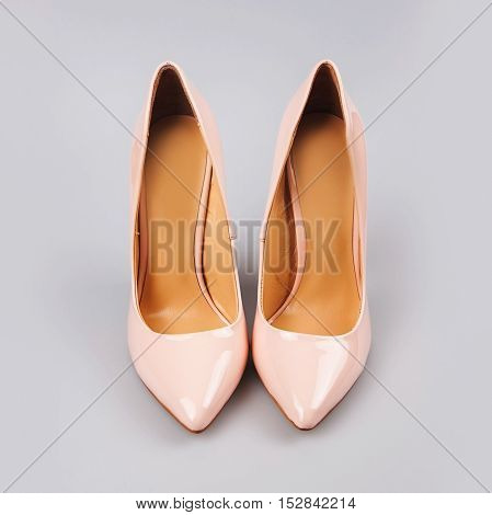 fashion female pink shoes in grey background