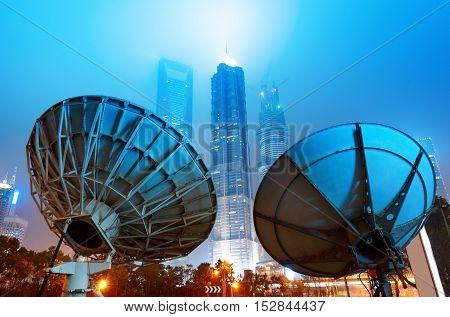 Skyscrapers and satellite antennas in Shanghai, China.