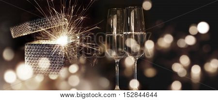 Fiery New Year wishes with sparkling wine and bokeh