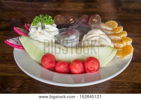 Mixed fruits with ice cream and dry ice