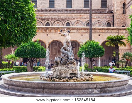 MONREALE ITALY - SEPTEMBER 8 2015: Fountain on the background of famous cathedral in Monreale near Palermo Sicily. Italy.
