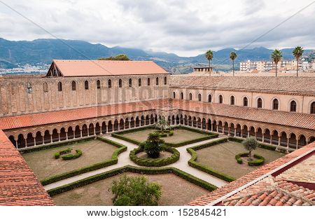 MONREALE ITALY - SEPTEMBER 8 2015: The medieval courtyard of the cathedral in Monreale near Palermo in Sicily Italy