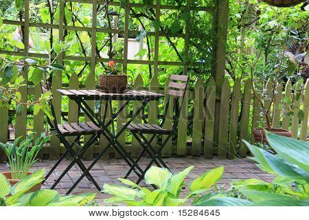 Patio furniture on a cozy little terrace.