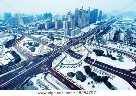 Snow Aerial modern city highway and viaduct.