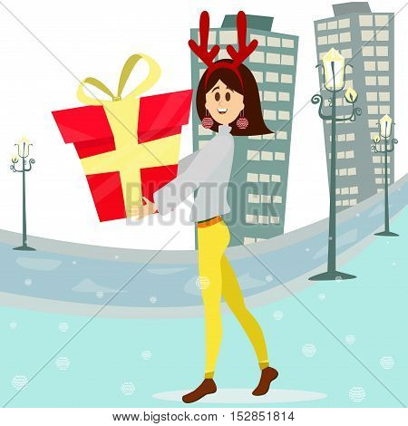 Happy woman carrying a big gift box.