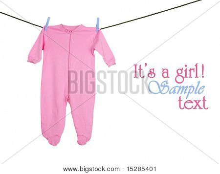 Pink sleeper hanging on the clothesline, studio isolated on white.